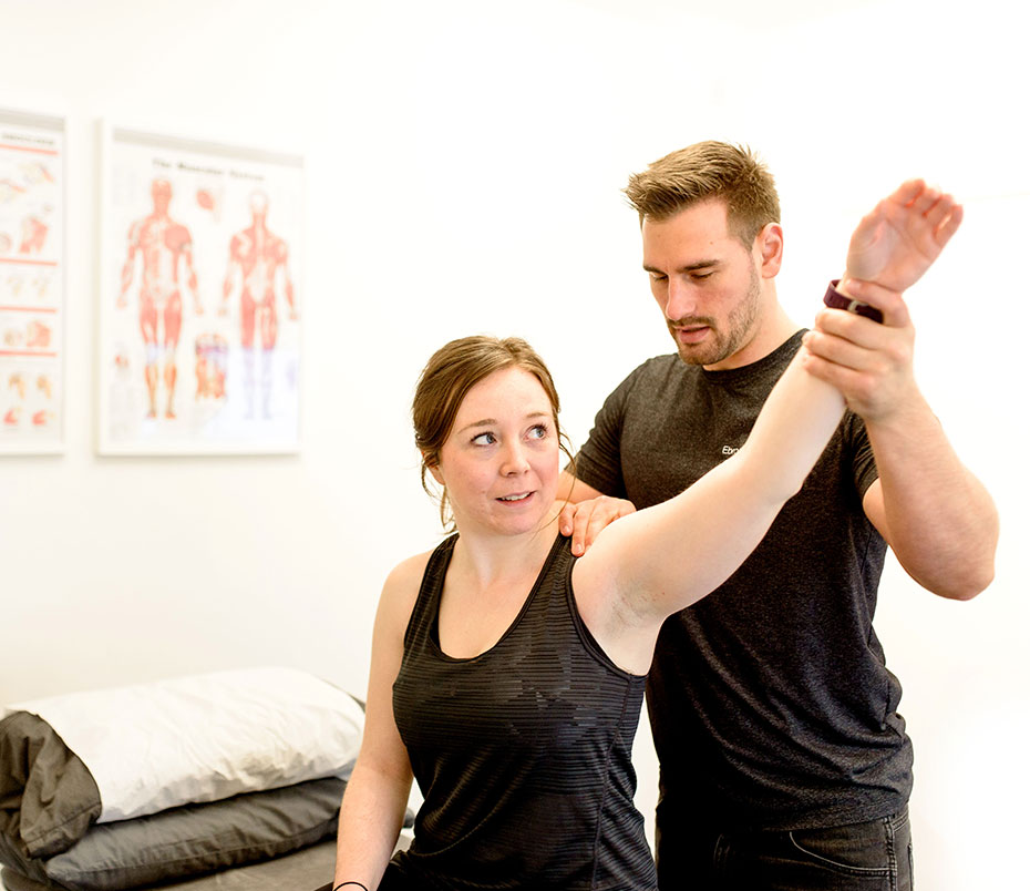 Osteopathy-assessing-a-shoulder
