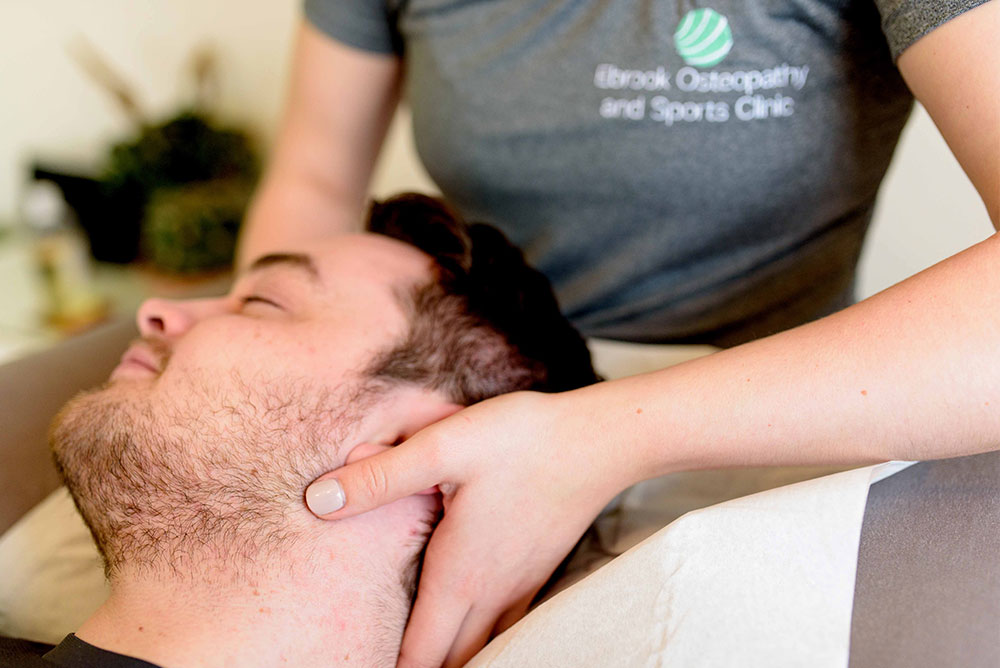 Osteopathy-hands-on-neck