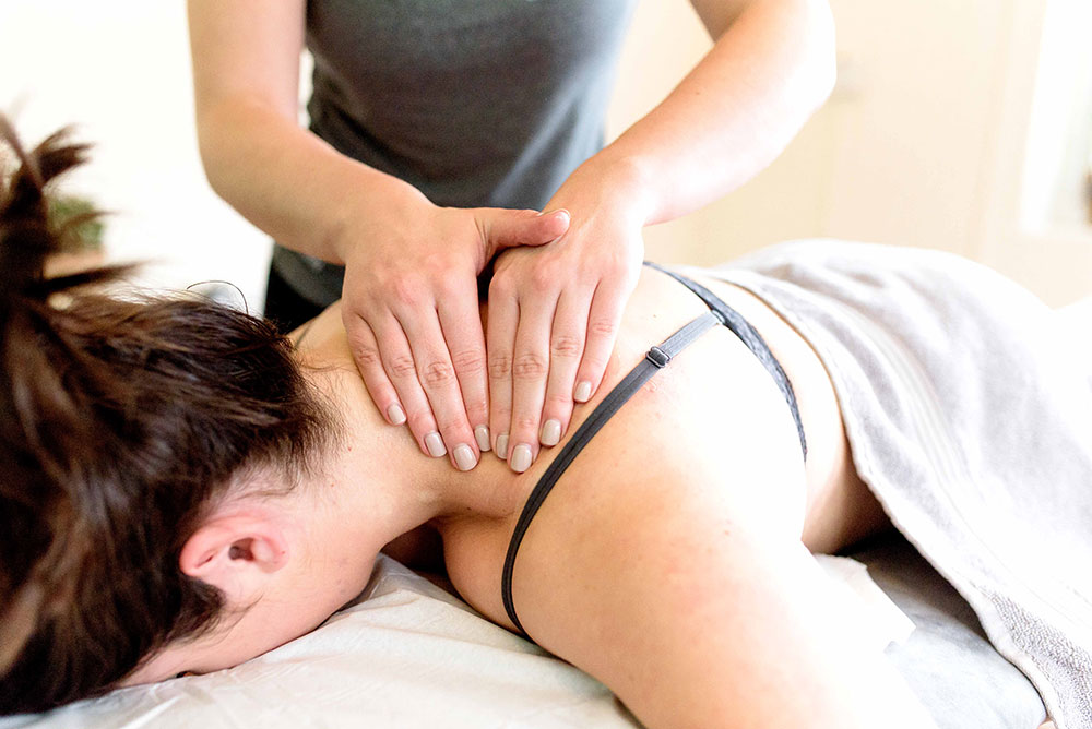 Sports-Massage-Hands-on-a-neck