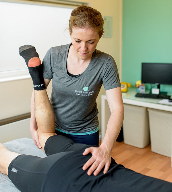 Sports-Massage-working-on-a-hip